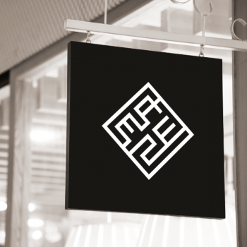 Maze logo design on hanging shop sign